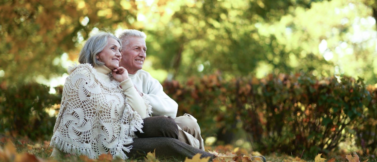 A senior couple relaxing outside.